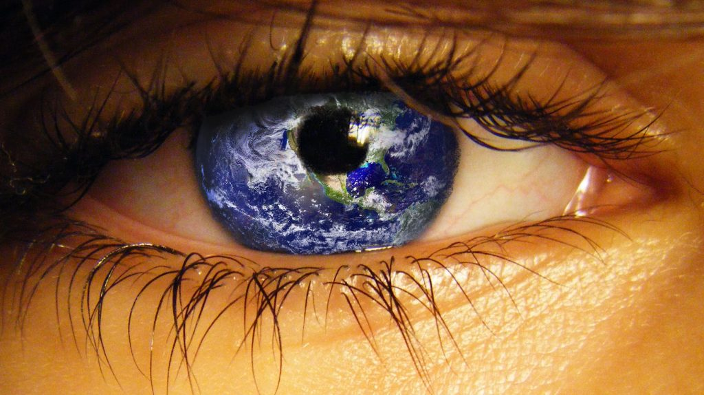 Human eye with world globe showing as the iris.